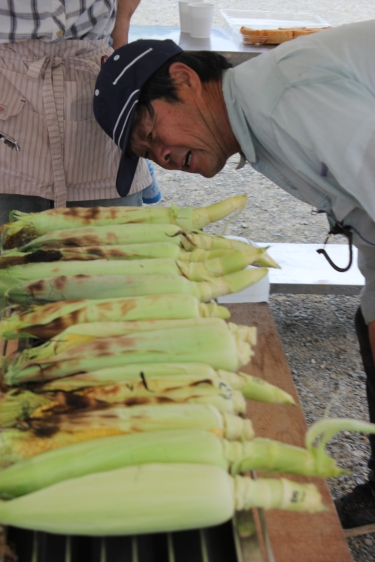 Mr. Fujimoto inspecting the grilled sweetcorn. Note, this service is not available to the public